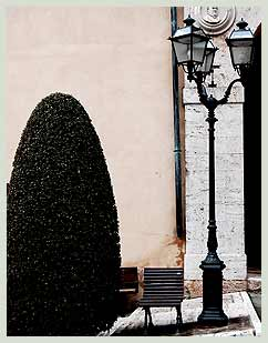Italian lamp and resting place in Sarteano square